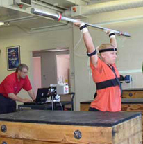 Olympic Weightlifter holding the bar overhead while instrumented